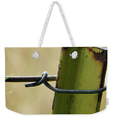 Weekender Tote Bag featuring the photograph Knotted Wired And Rusty by Tina M Wenger
