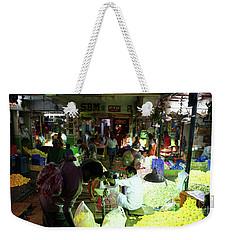 Weekender Tote Bag featuring the photograph Koyambedu Flower Market Stalls by Mike Reid