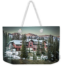 Weekender Tote Bag featuring the photograph Lake Louise Lodge by Bill Howard