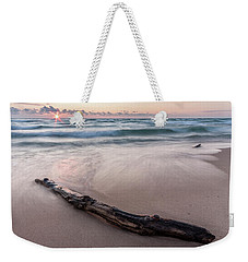 Weekender Tote Bag featuring the photograph Lake Michigan Driftwood by Adam Romanowicz