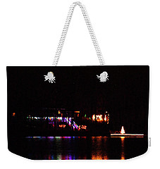 Weekender Tote Bag featuring the photograph Lakeside Display by Rick Friedle