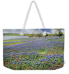 Weekender Tote Bag featuring the photograph Lakeside Texas Bluebonnets by David and Carol Kelly