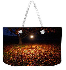 Weekender Tote Bag featuring the photograph Lamp-lit Leaves by Lars Lentz