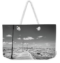 Weekender Tote Bag featuring the photograph Lamplit Walkway by Gary Gillette