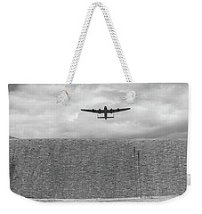 Weekender Tote Bag featuring the photograph Lancaster Over The Derwent Dam Bw Version by Gary Eason