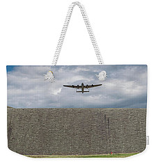 Weekender Tote Bag featuring the photograph Lancaster Over The Derwent Dam by Gary Eason