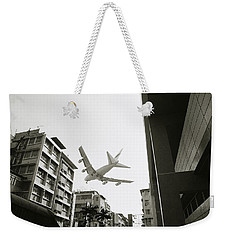 Landing In Hong Kong Weekender Tote Bag by Shaun Higson