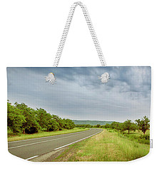 Landscape With Highway And Cloudy Sky Weekender Tote Bag by Vlad Baciu