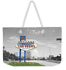 Weekender Tote Bag featuring the photograph Las Vegas Welcome Sign Color Splash Black And White by Shawn O'Brien