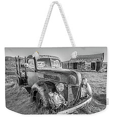 Weekender Tote Bag featuring the photograph Last Load  by Charles Garcia