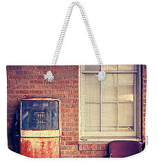 Weekender Tote Bag featuring the photograph Last Pump Standing by Trish Mistric
