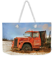 Weekender Tote Bag featuring the photograph Latsha Lumber Truck by Lori Deiter