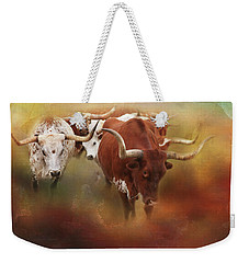 Weekender Tote Bag featuring the photograph Leading The Herd by Toni Hopper