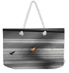 Leaf In Suspense Weekender Tote Bag by Jason Nicholas