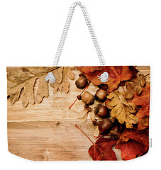 Weekender Tote Bag featuring the photograph Leaves And Nuts 1 by Rebecca Cozart
