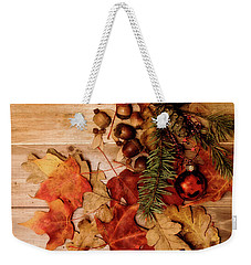 Weekender Tote Bag featuring the photograph Leaves And Nuts And Red Ornament by Rebecca Cozart