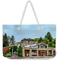 Weekender Tote Bag featuring the photograph Legs Inn Of Cross Village by Bill Gallagher