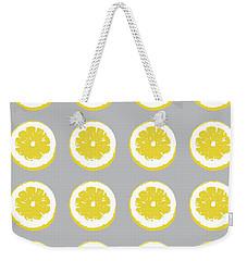 Weekender Tote Bag featuring the mixed media Lemon Slices On Grey- Art By Linda Woods by Linda Woods