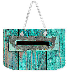 Weekender Tote Bag featuring the photograph Letter Box On Blue Wood by John Williams