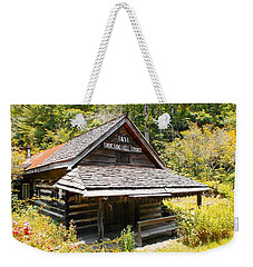 Weekender Tote Bag featuring the photograph Lick Log Vintage Store by Donna Dixon