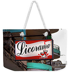 Weekender Tote Bag featuring the photograph Licorama Bar Liquor Store In Havana Cuba At Calle 6 by Charles Harden