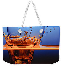 Weekender Tote Bag featuring the photograph Light Bulb And Splash Water by Setsiri Silapasuwanchai