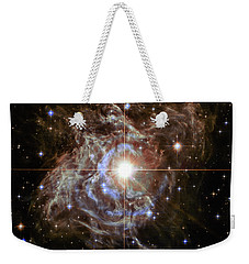 Weekender Tote Bag featuring the photograph Light Echoes by Marco Oliveira