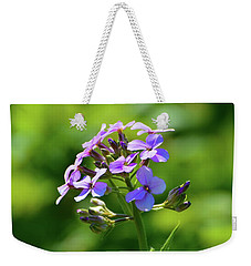 Weekender Tote Bag featuring the photograph Light Purple Flowers  by Lyle Crump