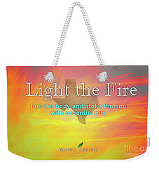 Weekender Tote Bag featuring the photograph Light The Fire by Cheryl McClure