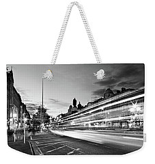 Weekender Tote Bag featuring the photograph Light Trails On O'connell Street At Night - Dublin by Barry O Carroll