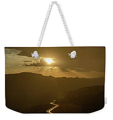 Weekender Tote Bag featuring the photograph Light Up The Highway In The Rain by Gaelyn Olmsted