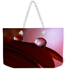 Light Water Drop On Dark Petals Weekender Tote Bag by Angela Murdock