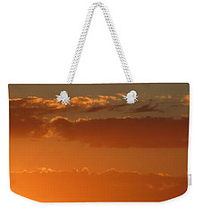 Weekender Tote Bag featuring the photograph Lighten Up by Marie Neder