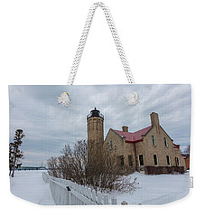 Weekender Tote Bag featuring the photograph Lighthouse And Mackinac Bridge Winter by John McGraw