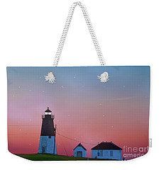 Weekender Tote Bag featuring the photograph  Lighthouse At Sunrise by Juli Scalzi