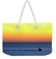 Weekender Tote Bag featuring the photograph Lighthouse At Sunrise On Lake Michigan by Zawhaus Photography