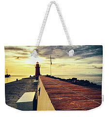 Weekender Tote Bag featuring the photograph Lighthouse At Sunset by Silvia Ganora