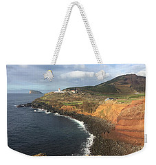 Weekender Tote Bag featuring the photograph Lighthouse On The Coast Of Terceira by Kelly Hazel