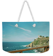 Lighthouse Over The Ocean Weekender Tote Bag
