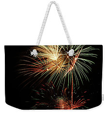 Weekender Tote Bag featuring the photograph Lighting Up The Night by Broderick Delaney