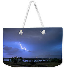 Weekender Tote Bag featuring the photograph Lightning Striking Over Boulder Reservoir by James BO Insogna