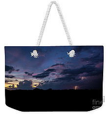 Weekender Tote Bag featuring the photograph Lightning Sunset by Brian Jones
