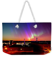 Weekender Tote Bag featuring the photograph Lights On The Horizon by Justin Moore