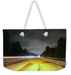 Weekender Tote Bag featuring the photograph Lightworks by Alex Grichenko