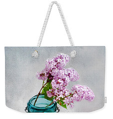 Weekender Tote Bag featuring the photograph Lilacs In A Glass Jar Still Life by Louise Kumpf