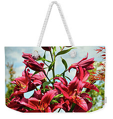 Weekender Tote Bag featuring the photograph Lilies In The Garden by Kerri Farley