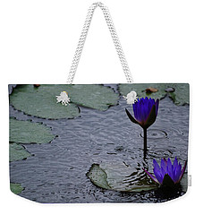 Weekender Tote Bag featuring the photograph Lilies In The Rain by Amee Cave