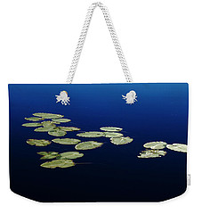 Weekender Tote Bag featuring the photograph Lily Pads Floating On River by Debbie Oppermann