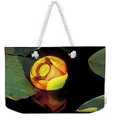 Weekender Tote Bag featuring the photograph Lily Reflection by Sandra Bronstein