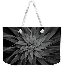 Weekender Tote Bag featuring the photograph Lily Swirl by Melissa Lane